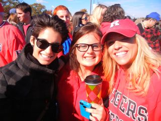 Recent grads, from left, who attended the tailgate included Samantha Coppolino '12, Hillary Goldsmith '13 and Carla Marie Monica '10. Photo by Ron Miskoff.