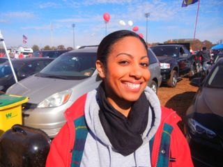 A smiling Stephanie Berryer Jean-Louis met up with friends and professors at the tailgate. Photo by Ron Miskoff.