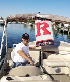 Mark Beal, J/MS 1989, a managing partner of a PR firm and Rutgers professor, still finds time to relax on his boat. Photo provided by Mark Beal.