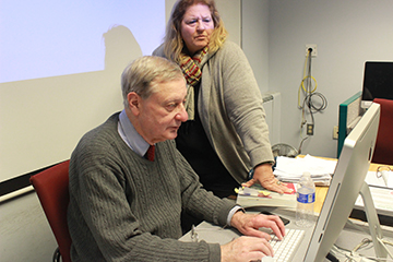 Professors Ron Miskoff and Liz Fuerst review the iBook. Photo by Fatimah Foster