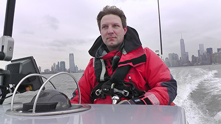 Bjoern Kils captains his New York Media Boat in the waters of the Hudson River. Photo by Lisa Marie Segarra