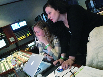 Patrizia Di Maria, right, with ex-intern (now director) Lauren Quinn, a 2001 grad, producing the Lady Gaga show. Photo provided by Patrizia Di Maria