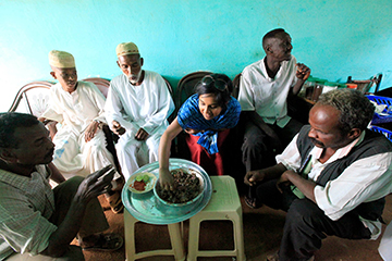 Deepa Babington tries camel liver for a story in Sudan.