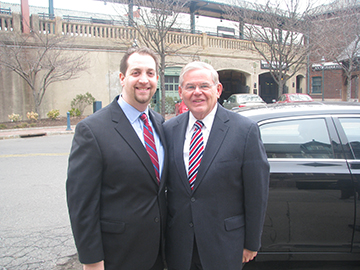 Steven Sandberg, left, with U.S. Sen. Robert Menendez. Sandberg, a 2000 graduate, made the move from journalist to press secretary. Photo provided by Steven Sandberg
