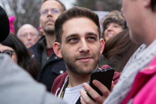 Photojournalist, Jeremy Berkowitz hits the Women's March in Washington D.C. with his camera and phone recorder. Photo credit: Nancy Adler
